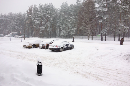 driving conditions: Borisov, Belarus - January 13, 2016: Natural disasters, snow storm with heavy snow paralyzed the city. Kolaps. Snow covered the cyclone Daniella in Europe, January 13, 2016 in Borisov, Belarus.