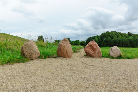 street shots: view of huge stones and the hill behind them
