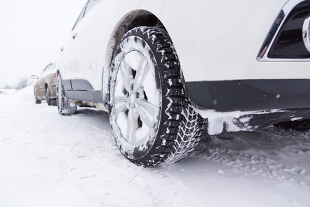 non urban scene: cars with winter tires are on the snow-covered ground Stock Photo