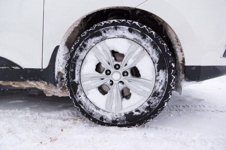 cars with winter tires are on the snow-covered ground