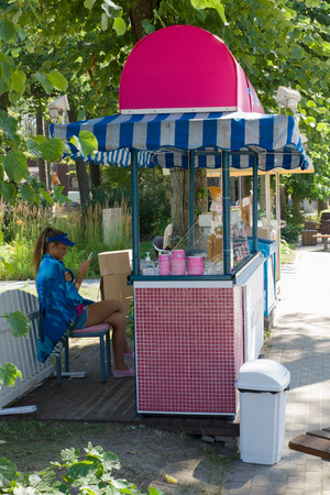 latvia girls: JURMALA, LATVIA - AUGUST 07: Features architectural development of the city on August 02, 2015 in Jurmala, Latvia. Girl sells ice cream on the street. Editorial