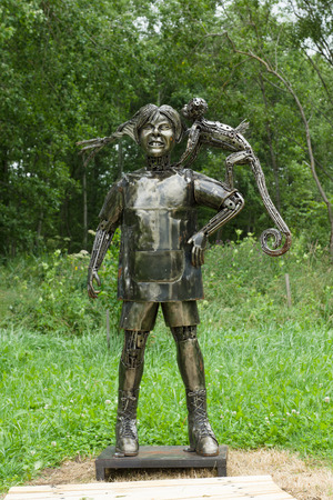 farmstead: Rapaliai, Lithuania - July 26,2015:  Manor of Golden Deer are the country tourism farmstead, located on picturesque historical Samogitia locality, near Virvyte river in Lithuania. The location is well known for his sculptures of spare parts of automobiles