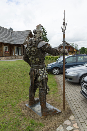 locality: Rapaliai, Lithuania - July 26,2015:  Manor of Golden Deer are the country tourism farmstead, located on picturesque historical Samogitia locality, near Virvyte river in Lithuania. The location is well known for his sculptures of spare parts of automobiles