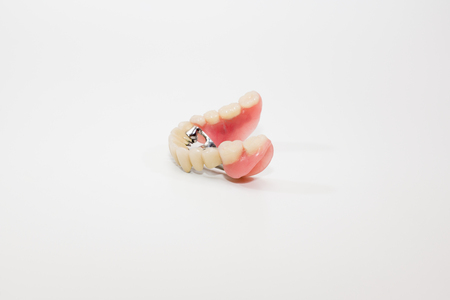 surrogate: arc denture with ceramic-metal crowns on a white background