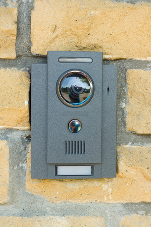 possession: the on-door speakerphone is located on a brick wall in private possession