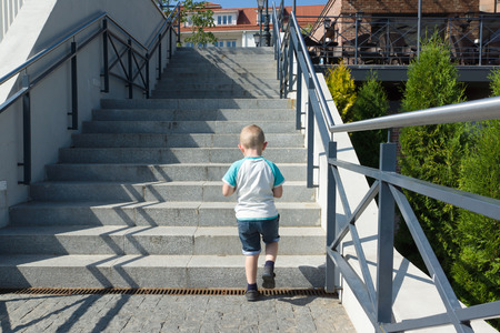 upstairs: the little boy in shorts rises on a steep ladder