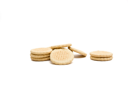 heaped: Round delicious cookies lie heaped on a white background Stock Photo