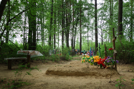 deceased: Borisov, Belarus - 10 May 2016: Radunica - spring holiday of remembrance of the dead in the eastern Slavs. People come to the cemetery to remember deceased relatives.