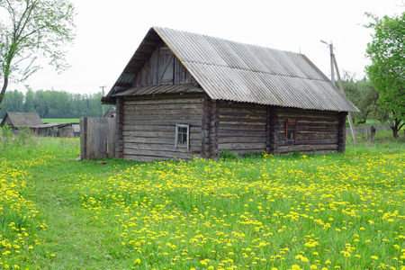 stoop: old wooden house stands alone in the abandoned village people