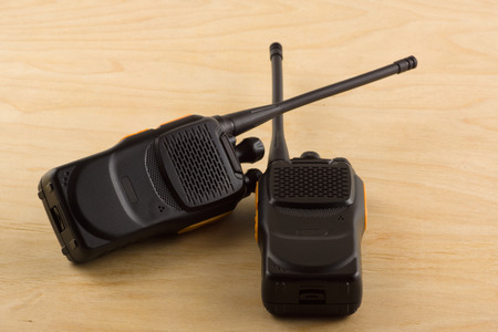 walkie talkie: New walkie talkie isolated on wooden background