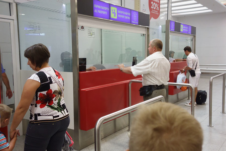 airport customs: Burgas, Bulgaria - June 19, 2016: people pass inspection in the customs control zone of the airport