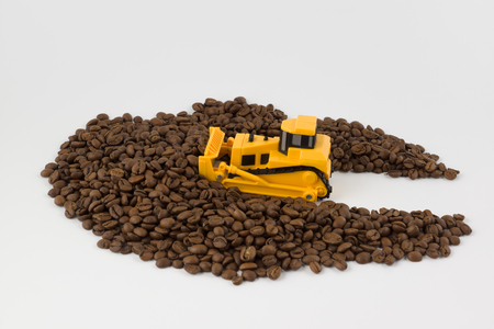 small yellow industrial vehicles work with coffee beans Stock Photo