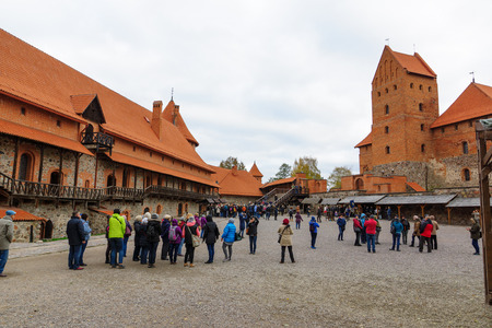 hundreds and thousands: Trakai, Lithuania - October 16, 2016: Trakai castle on the lakes is visited by hundreds of thousands of tourists every year. The courtyard of the castle. Editorial