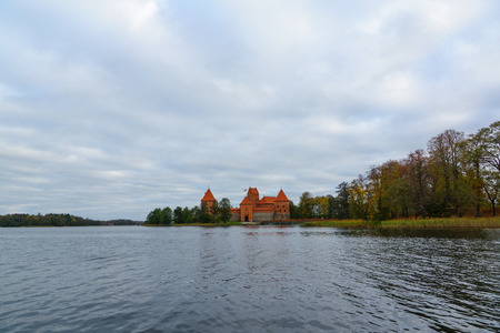 hundreds and thousands: Trakai, Lithuania - October 16, 2016: Trakai castle on the lakes is visited by hundreds of thousands of tourists every year.