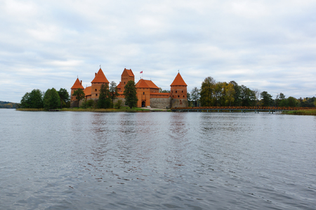 hundreds: Trakai, Lithuania - October 16, 2016: Trakai castle on the lakes is visited by hundreds of thousands of tourists every year.