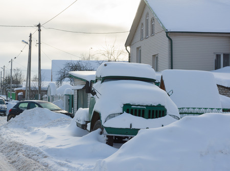 truck standing on the roadside in the snow