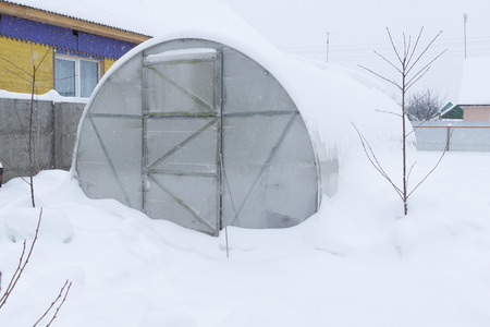 inscribed: large glass greenhouse inscribed layer of snow Stock Photo