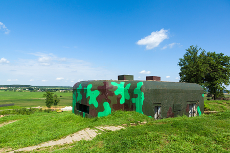 military fortification built of concrete and serves as a point of fire in battle