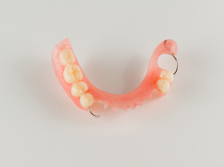 acrylic denture with metal clasps for restoring dentition Stock Photo