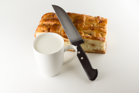strudel: fresh cake with apple filling on a white background