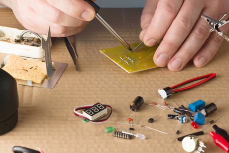 manual test equipment: master repairs electronic equipment at his workplace