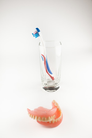 Acrylic removable prosthesis lies on a white background
