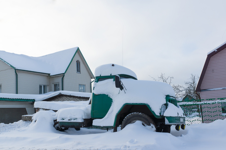 winter tires: truck standing on the roadside in the snow