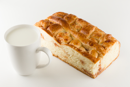 fresh cake with apple filling on a white background