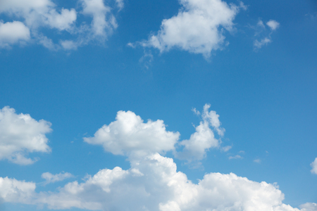 lot of white clouds hanging against the blue sky Stock Photo