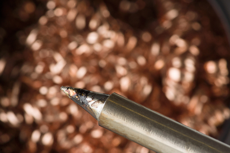Metal chips in the tank is used to clean the soldering iron from the deposit Stock Photo