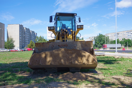 Borisov, Belarus - July 05, 2018: powerful road construction equipment on the construction of a highway. Éditoriale