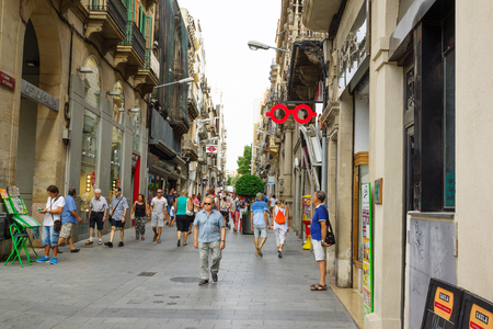 Reus, Spain - August 16, 2017: Streets of Reus on hot sunny day. Reus is also a gateway to the Costa Daurada's sparkling beaches.Reus is the birthplace of the great architect Gaudi. Editorial
