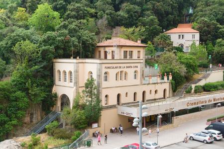 Montserrat, Spain - August 18, 2018: Santa Maria de Montserrat abbey in Monistrol, in a beautiful summer day, Catalonia, Spain