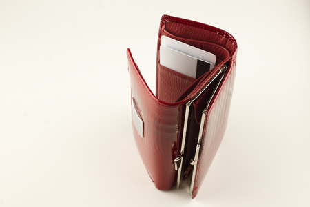 new leather red wallet on a white background