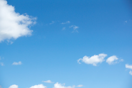 lot of white clouds hanging against the blue sky