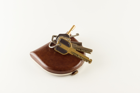 apartment keys and leather wallet with small coins