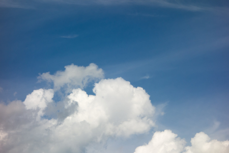 white clouds on deep blue sky background