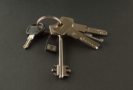 big bunch of keys to the apartment on a black background