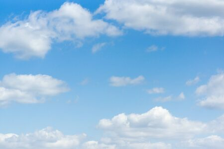 Blue sky with white light clouds in the foreground