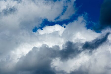 Blue sky with white light clouds in the foreground Stockfoto - 129759265