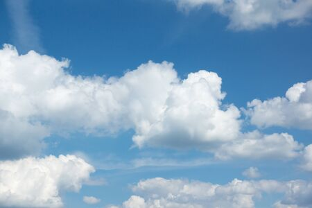 lot of white clouds hanging against the blue sky 스톡 콘텐츠