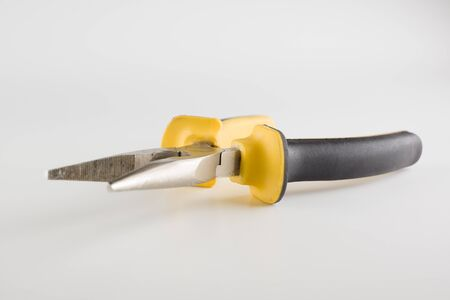 pliers with a long working part and dielectric handles are isolated on a white background