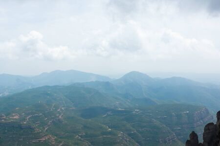 landscape with vast mountainous terrain covered with vegetation