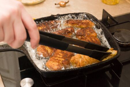 cooking nuggets from fresh chicken meat on a hot cast-iron pan