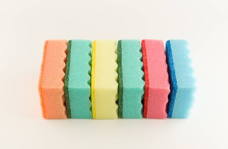 colorful foam rubber sponges isolated on a white background for washing dishes