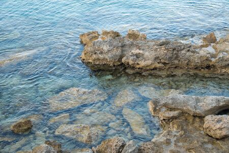 huge stones stick out of sea water