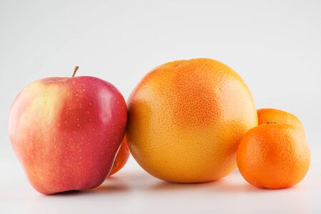 Food Related Apples and Orange Isolated on a White Background Foto de archivo