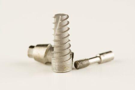 dental titanium implant with locking elements isolated on white background Stock fotó