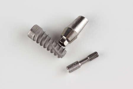dental titanium implant with locking elements isolated on white background