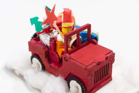small Christmas toy homemade in the form of a car with gifts Stock Photo
